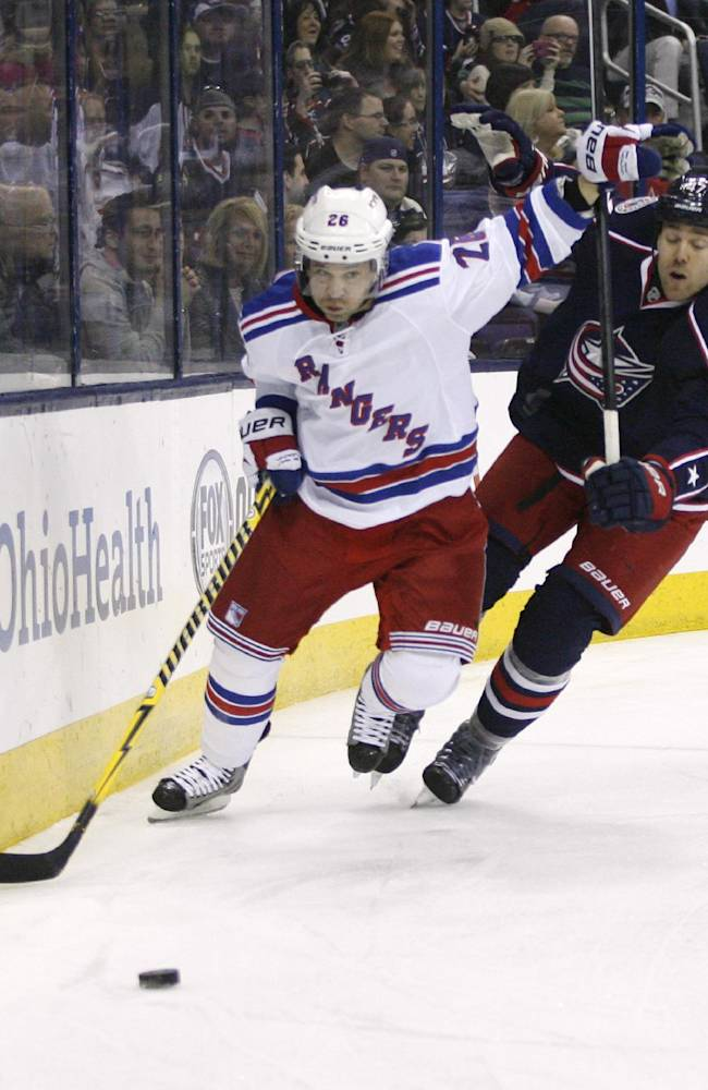 Columbus Blue Jackets' Dalton Prout (47) chases New York Rangers' Martin St. Louis (26) behind the net during the first period of an NHL hockey game, Friday, March 21, 2014, in Columbus, Ohio