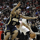 Houston Rockets' Jeremy Lin, right, tries to maintain control of the ball while colliding with Indiana Pacers' Evan Turner (12) in the first half of an NBA basketball game on Friday, March 7, 2014, in Houston The Associated Press