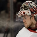 Detroit Red Wings goalie Jimmy Howard spits water during the second period of Game 1 of an NHL hockey playoffs Western Conference semifinal against the Chicago Blackhawks in Chicago, Wednesday, May 15, 2013. The Blackhawks won 4-1. (AP Photo/Nam Y. Huh)