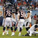 Chicago Bears defensive end Trevor Scott (76) is congratulated by teammates after he sacked Jacksonville Jaguars quarterback Chad Henne, right, during the first half of an NFL preseason football game in Chicago, Thursday, Aug. 14, 2014 The Associated Pres