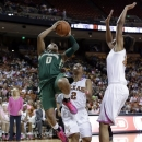 Baylor's Odyssey Sims (0) shoots over Texas' Celina Rodrigo (2) and Imani McGee-Stafford, right, during the first half of an NCAA college basketball game, Saturday, Feb. 9, 2013, in Austin, Texas. (AP Photo/Eric Gay)