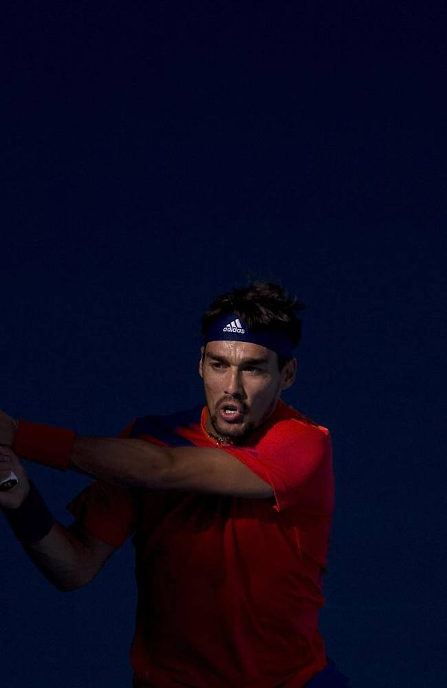 Fabio Fognini of Italy returns a shot against Lleyton Hewitt of Australia during the China Open tennis tournament at the National Tennis Stadium in Beijing, China, Wednesday, Oct. 2, 2013