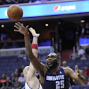 Charlotte Bobcats center Al Jefferson (25) goes to the basket against Washington Wizards center Marcin Gortat, left, of Poland, during the first half of an NBA basketball game on Wednesday, April 9, 2014, in Washington The Associated Press