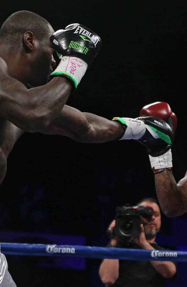 WBC Continental Americas Heavyweight Champion Deontay Wilder, left, fights with Malik Scott during their heavyweight bout at the Ruben Rodriguez Coliseum in Bayamon, Puerto Rico, Saturday, March 15, 2014. Wilder defeated Scott by knock out in the first round