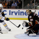 Anaheim Ducks goalie Frederik Andersen, right, blocks a shot by Buffalo Sabres right wing Drew Stafford during the first period of an NHL hockey game in Anaheim, Calif., Wednesday, Oct. 22, 2014. (AP Photo/Chris Carlson)