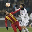 Rio Ave's Diego Lopes, left, challenges for the ball against Danilo Silva of Dynamo Kiev during a Europa League Group J soccer match between Dynamo Kiev and Rio Ave at the Olympiyskiy national stadium in Kiev, Ukraine, Thursday, Nov. 27, 2014 The Associat