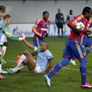 CSKA's Seydou Doumbia, front right, jogs with the ball after he scored his side's first goal during the Group E Champions League match between CSKA Moscow and Manchester City at Arena Khimki stadium in Moscow, Russia, Tuesday, Oct. 21, 2014