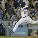Rollins rallies Dodgers past his old Phillies team, 10-7 The Associated Press