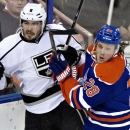 Los Angeles Kings Drew Doughty (8) is checked by Edmonton Oilers Ryan Jones (28) during third period NHL hockey action in Edmonton, Alberta, on Sunday March 9, 2014 The Associated Press