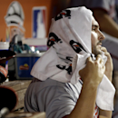 Washington Nationals starting pitcher Tanner Roark wraps a towel around his head after pitching during the fifth inning of a baseball game against the Miami Marlins, Wednesday, April 16, 2014, in Miami The Associated Press