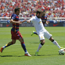 Manchester United's Juan Mata, right, struggles for the ball with FC Barcelona's Pedro Rodriguez during an International Champions Cup soccer match at Levi's Stadium, Saturday, June 25, 2015, in Santa Clara, Calif. (Tomas Ovalle/AP Images for