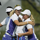 Europe's Suzann Pettersen, left, of Norway, and Europe's Caroline Hedwall, right, of Sweden, celebrate their win on the 16th hole during a foursome match in the Solheim Cup golf tournament, Friday, Aug. 16, 2013, in Parker, Colo. (AP Photo/Chris Carlson)