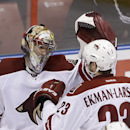 Phoenix Coyotes goalie Mike Smith, left, and defenseman Oliver Ekman-Larsson (23), of Sweden, congratulate each other after the Coyotes defeated the Florida Panthers 3-1 in an NHL hockey game, Tuesday, March 11, 2014, in Sunrise, Fla The Associated Press