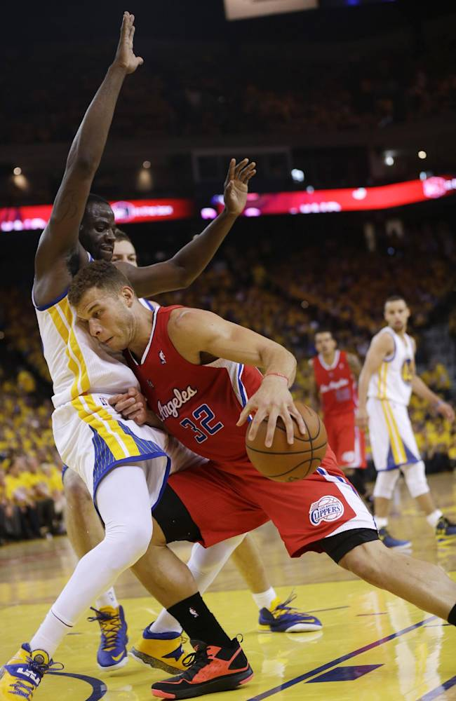 Los Angeles Clippers' Blake Griffin, right, is defended by Golden State Warriors' Draymond Green during the first half in Game 6 of an opening-round NBA basketball playoff series on Thursday, May 1, 2014, in Oakland, Calif