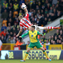Norwich City's Gary Hooper, front, and Stoke City's Ryan Shawcross battle for the ball during their English Premier League soccer match at Carrow Road, Norwich, England, Saturday, March 8, 2014