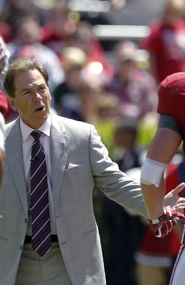Alabama coach Nick Saban reacts to a breakdown with defensive players Alabama defensive back Jabriel Washington (23) and linebacker Dillon Lee (25) during Alabama's A-Day NCAA college football spring game Saturday, April 19, 2014, in Tuscaloosa, Ala