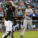 Arizona Diamondbacks catcher Miguel Montero, left, watches as New York Mets' Lucas Duda scores on a base hit by Kirk Nieuwenhuis during the first inning of the MLB National League baseball game on Tuesday, April 15, 2014, in Phoenix The Associated Press