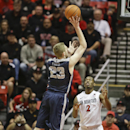 Utah State forward Kyle Davis scores over San Diego State guard Xavier Thames during the first half of a NCAA college basketball game Tuesday, Feb. 18, 2014, The Associated Press