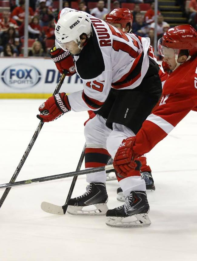 Detroit Red Wings' Luke Glendening (41) tries to block a pass by New Jersey Devils' Tuomo Ruutu (15), of Finland, during the first period of an NHL hockey game Friday, March 7, 2014, in Detroit