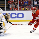 Boston Bruins goalie Tuukka Rask (40) stops a shot by Detroit Red Wings right wing Luke Glendening (41) in the second period of an NHL hockey game in Detroit, Wednesday, Oct. 15, 2014 The Associated Press