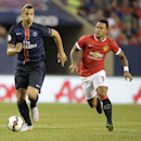 Paris Saint-Germain's Zlatan Ibrahimovic brings the ball up infront of Manchester United's Memphis Depay during International Champions Cup play in Chicago Wednesday, July 29, 2015. (AJ Mast / AP Images for International Champions Cup)