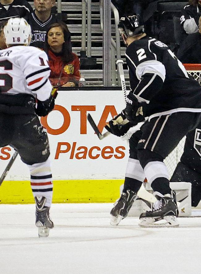 Chicago Blackhawks center Marcus Kruger (16) scores a goal against Los Angeles Kings goalie Jonathan Quick (32) and defenseman Matt Greene (2) in the second period of an NHL hockey game in Los Angeles, Monday, Feb. 3, 2014