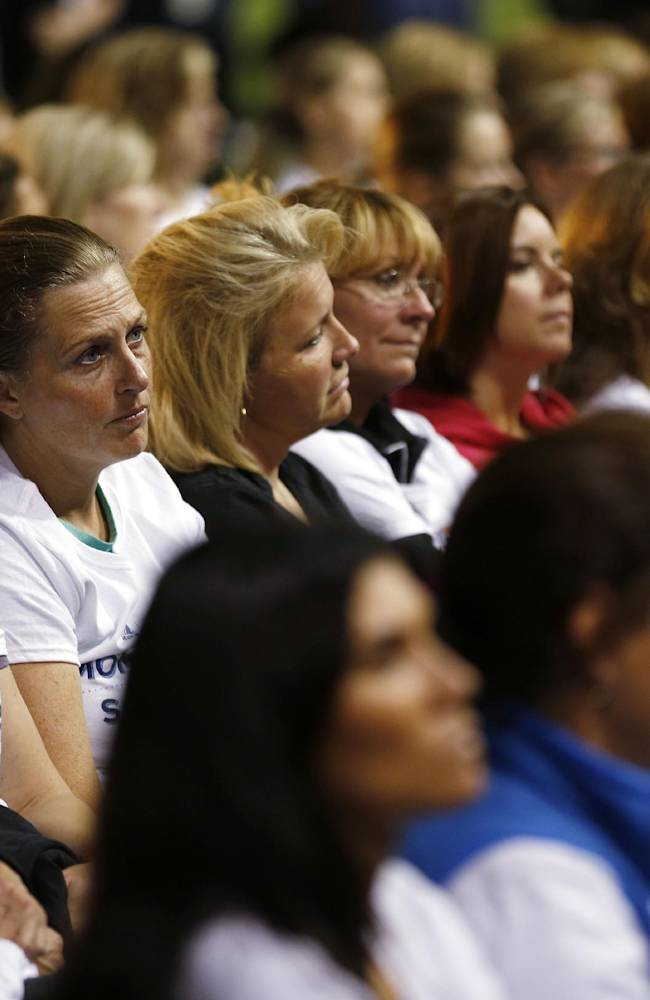 Participants listen to speakers during a safety clinic hosted by the NFL and the Chicago Bears for the mothers of youth football players on Tuesday, Oct. 29, 2013, at Halas Hall in Lake Forest, Ill