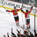 Chicago Blackhawks center Jonathan Toews (19) and Brandon Saad (20) celebrate Saad's goal during the first period of an NHL hockey game against the Winnipeg Jets Friday, Jan. 16, 2015, in Chicago The Associated Press