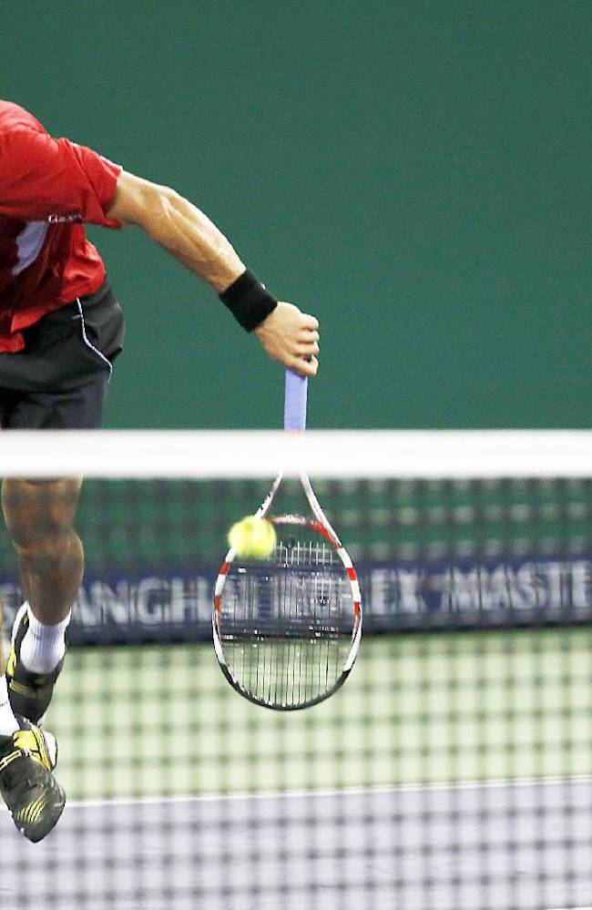 Alejandro Falla of Colombia, chases the ball to return against  Yen-Hsun Lu of Taiwan at the qualifying round of the Shanghai Masters tennis tournament at Qizhong Forest Sports City Tennis Center in Shanghai, China, Sunday, Oct. 6, 2013. Falla won the match 6-4-, 6-3