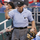 This june 5, 2014, file photo shows umpire Dale Scott calling out St. Louis Cardinals' Yadier Molina after a play review in the fifth inning of a baseball game against the Kansas City Royals at Kauffman Stadium in Kansas City, Mo. Major League Baseball um