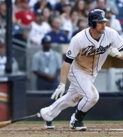 San Diego Padres' Chase Headley, right, heads toward first as he watches his two-RBI single slip into right field against the Atlanta Braves during the fifth inning of a baseball game on Wednesday, Aug. 29, 2012, in San Diego. (AP Photo/Lenny Ignelzi)