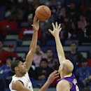 New Orleans Pelicans power forward Anthony Davis (23) shoots over Los Angeles Lakers center Chris Kaman (9) in the first half of an NBA basketball game in New Orleans, Friday, Nov. 8, 2013 The Associated Press