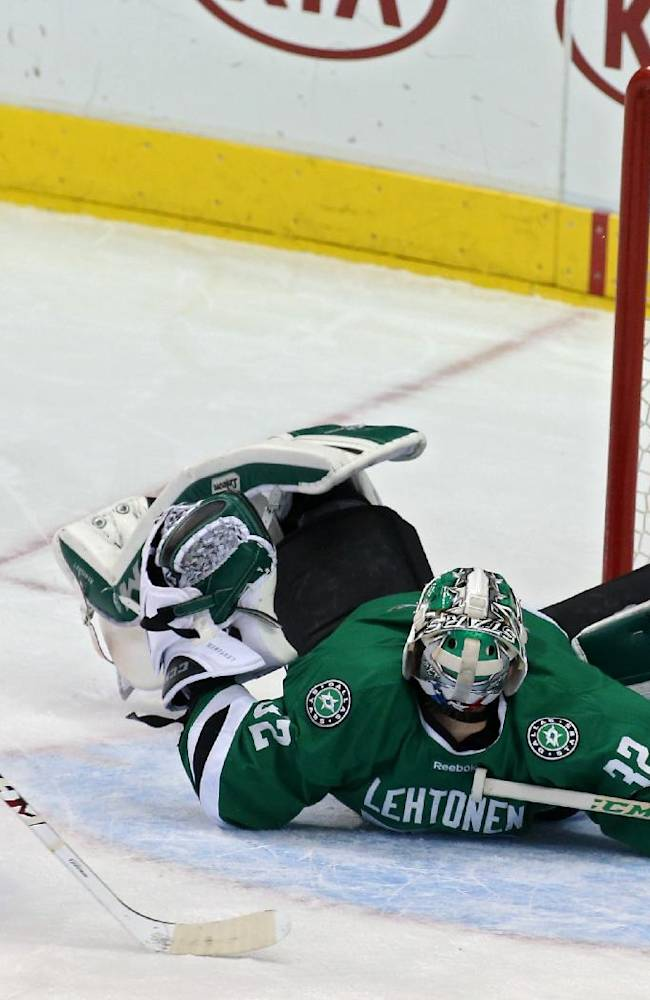 Montreal Canadiens center David Deshamais (51) tries to get the puck past Dallas Stars goalie Kari Lehtonen (32), of FInland, during the third period of an NHL hockey game Thursday, Jan. 2, 2014, in Dallas. Montreal won 6-4