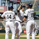 Colorado Rockies' Justin Morneau (33) is congratulated at the plate by Josh Rutledge (14), and Charlie Blackmon (19) after hitting a three-run home run off Los Angeles Dodgers starting pitcher Carlos Frias during the first inning of a baseball game Wednesday, Sept. 17, 2014, in Denver. (AP Photo/Jack Dempsey)