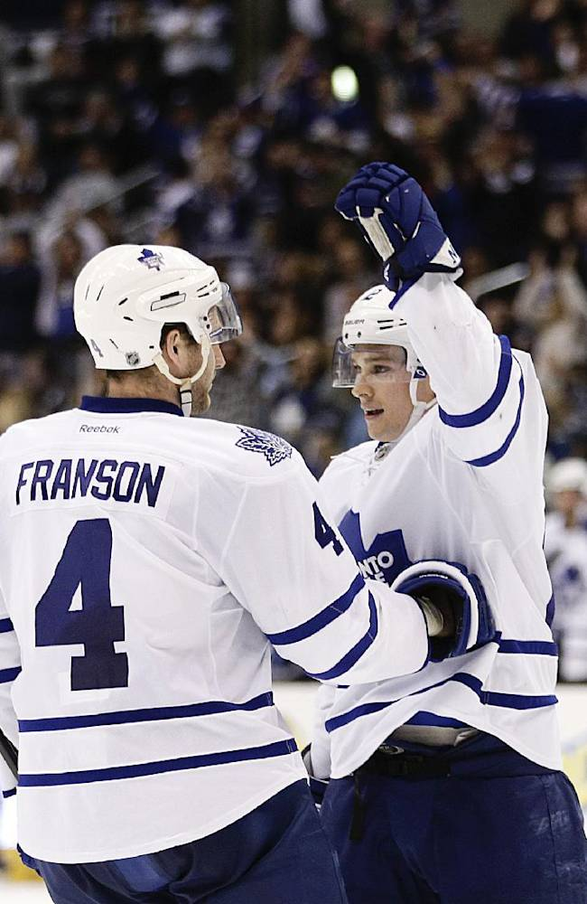 Toronto Maple Leafs' Mason Raymond, right, celebrates his goal with Cody Franson during the third period of an NHL hockey game against the Los Angeles Kings on Thursday, March 13, 2014, in Los Angeles. The Maple Leafs won 3-2