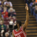 Houston Rockets guard James Harden flashes three fingers after scoring a three-point basket during the third quarter of an NBA basketball game agains the Sacramento Kings in Sacramento, Calif., Tuesday Feb. 25, 2014. Harden scored 43 points in the Rocket