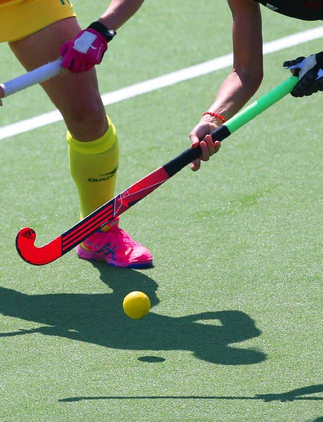 Australia's Edwina Bone, left and Wales Julia Wilkinson, right, clash for the ball during their side's field hockey match at the Commonwealth Games Glasgow 2014, Glasgow National Hockey Centre, Scotland, Friday, July 25, 2014 . The games run till August 3, with 71 countries and 2 territories taking part