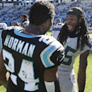 Seattle Seahawks cornerback Richard Sherman (25) speaks with Carolina Panthers cornerback Josh Norman (24) after the second half of an NFL football game, Sunday, Oct. 26, 2014, in Charlotte. The Seattle Seahawks won 13-9 The Associated Press