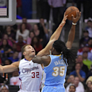 Denver Nuggets forward Kenneth Faried, right, shoots as Los Angeles Clippers forward Blake Griffin defends during the first half of an NBA basketball game, Tuesday, April 15, 2014, in Los Angeles The Associated Press
