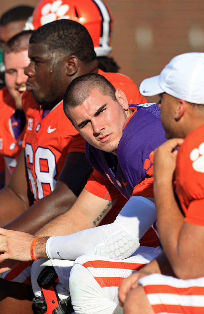 Clemson quarterback Chad Kelly, center, sits on the bench during the second half of the Tigers' NCAA college football spring game at Memorial Stadium in Clemson, S.C. on Saturday, April 12, 2014. Head coach Dabo Swinney announced on Monday, April 14,  that Kelly was dismissed from the team