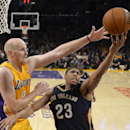 New Orleans Pelicans forward Anthony Davis, right, puts up a shot as Los Angeles Lakers center Chris Kaman defends during the second half of an NBA basketball game, Tuesday, Nov. 12, 2013, in Los Angeles The Associated Press