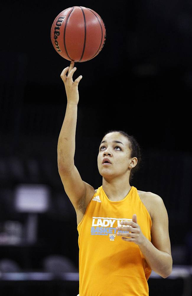 FILE -- In this March 30, 2013, file photo, Tennessee's Andraya Carter spins a ball during practice for a regional semifinal in the women's NCAA college basketball tournament in Oklahoma City. Carter's teammates say she developed into a team leader as a freshman last year despite missing most of the season with a shoulder injury. Now she's back on the floor and ready to boost a point guard position that lacked depth last season