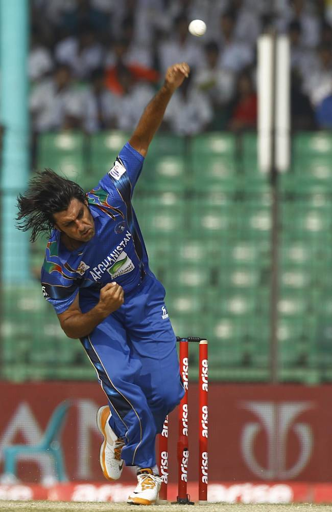Afghanistan's Shapoor Zadran bowls during their match against Pakistan in the Asia Cup one-day international cricket tournament in Fatullah, near Dhaka, Bangladesh, Thursday, Feb. 27, 2014