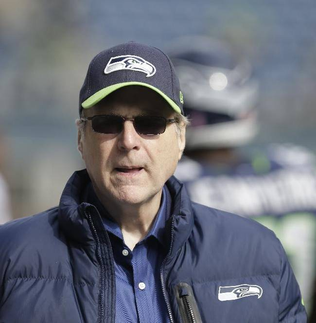 Seattle Seahawks owner Paul Allen stands on the sidelines before an NFL football game against the Tennessee Titans, Sunday, Oct. 13, 2013, in Seattle