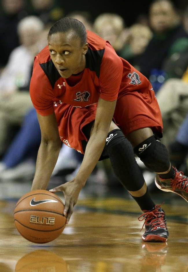 Texas Tech's Amber Battle (12) picks up a loose ball at mid court during an NCAA college basketball game against Baylor, Wednesday, Jan. 29, 2014, in Waco, Texas