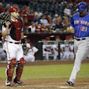 New York Mets' Lucas Duda (21) runs past Arizona Diamondbacks' Miguel Montero, left, to score a run during the second inning of a baseball game on Monday, April 14, 2014, in Phoenix The Associated Press
