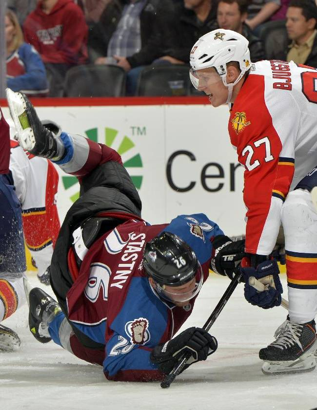 Colorado Avalanche center Paul Stastny (26) trips against Florida Panthers center Nick Bjugstad (27) during the first period of an NHL hockey game, Saturday, Nov. 16, 2013, in Denver