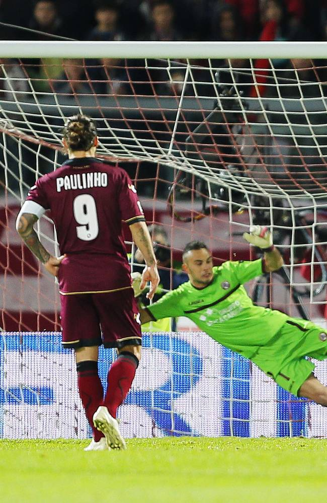 Napoli's Dries Mertens of Belgium, left partially covered, scores during a Serie A soccer match between Livorno and Napoli, in Leighorn, Italy, Sunday, March 2, 2014