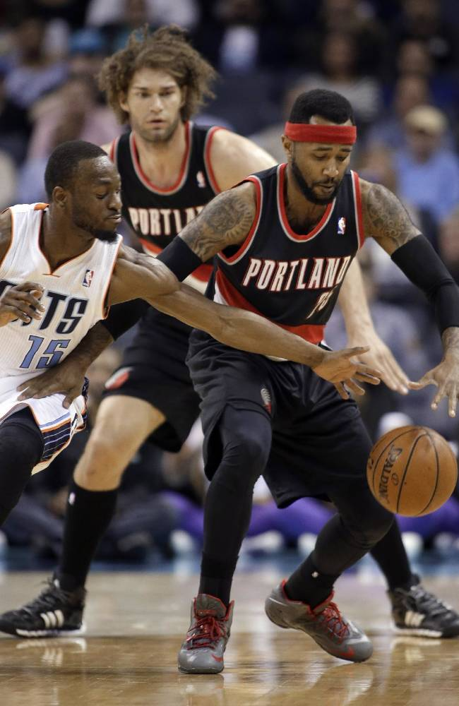 Charlotte Bobcats' Kemba Walker, left stretches to make a steal from Portland Trail Blazers' Mo Williams, right as Portland Trail Blazers' Robin Lopez watches from behind during the first half of an NBA basketball game in Charlotte, N.C., Saturday, March 22, 2014