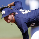Notre Dame's Sean Guenther delivers a pitch during the third inning of an NCAA college ACC tournament baseball game against Miami in Durham, N.C., Saturday, May 23, 2015. (AP Photo/Karl B DeBlaker)